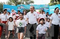 Sự kiện đi bộ vận động toàn dân đội mũ bảo hiểm cho trẻ em