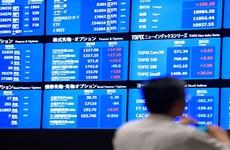 Thị trường toàn cầu hưởng ứng quyết định hạ lãi suất của Fed