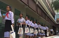 COVID-19: Lào đóng trường học, Indonesia ngăn sự kiện có 8.000 người