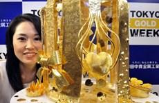 Giá vàng châu Á tiếp tục đi xuống do đồng USD tăng giá