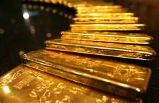 Đồng USD mạnh lên, giá vàng chạm mức thấp nhất trong 5 năm