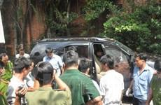 Phát hiện hai người chết trong chiếc ôtô với nhiều vết đạn bắn