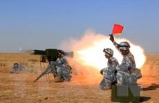 Khoảng 100 phần tử bịt mặt phá hủy các trạm an ninh ở Trung Quốc