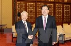 Tổng Bí thư hội kiến Ủy viên trưởng Nhân đại Trung Quốc