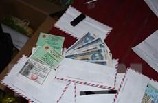 Bắt giữ cặp vợ chồng scan tiền mệnh giá 5.000 đồng để tiêu thụ