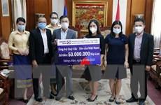 Người Việt tại Lào ủng hộ cuộc chiến chống COVID-19 tại quê nhà