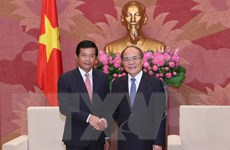 Chủ tịch Quốc hội Nguyễn Sinh Hùng tiếp Đại sứ Lào đến chào từ biệt