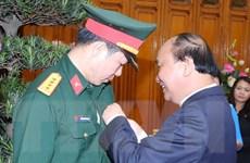 [Photo] Thủ tướng trao huân chương cho xạ thủ Hoàng Xuân Vinh