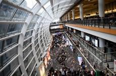 Cận cảnh sân bay Hong Kong nối lại hoạt động sau biểu tình