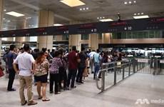 Singapore chấm dứt cho phép công dân Malaysia dùng 'hộ chiếu nhóm'