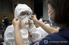 Hàn Quốc: Số người nhiễm COVID-19 lên 1.766, đã có 13 ca tử vong