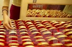 Giá vàng châu Á phiên chiều 14/7 vẫn quanh mức cao nhất 9 năm