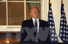 Ông Trump lần đầu trở lại Phòng Bầu dục sau khi mắc COVID-19