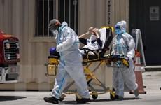COVID-19: Nhiều bang của Mỹ đối mặt với tốc độ lây nhiễm chóng mặt