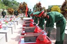 An táng hài cốt 9 liệt sỹ quân tình nguyện, chuyên gia hy sinh tại Lào