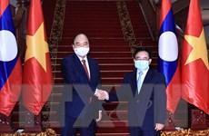 Chủ tịch nước Nguyễn Xuân Phúc hội kiến Thủ tướng Chính phủ Lào