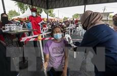 Dịch COVID-19: Malaysia đổi chiến lược về miễn dịch cộng đồng