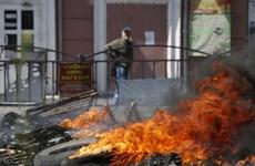 Một xe buýt ở miền Đông Ukraine bị trúng tên lửa Grad tầm xa