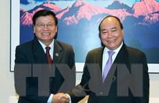 Thủ tướng Việt Nam-Lào gặp nhau bên thềm Hội nghị ASEM