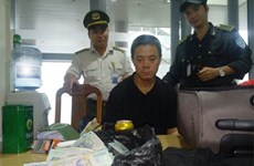 Du khách Trung Quốc trộm hơn 400 triệu đồng trên máy bay