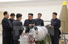 Mở đại tiệc, ông Kim Jong-un tuyên bố đẩy mạnh răn đe hạt nhân