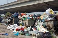 Người dân dỡ bỏ lán, dừng chặn xe chở rác vào bãi Nam Sơn