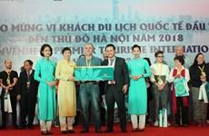 Khách quốc tế đầu tiên 'xông đất' Hà Nội và TP.HCM năm 2018