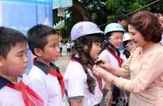Kêu gọi cả cộng đồng đội mũ bảo hiểm cho trẻ em