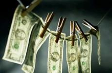 Nhật phát hiện tài khoản rửa tiền buôn lậu vũ khí của Triều Tiên
