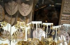 Giá vàng thế giới sụt giảm xuống mức thấp trong 4 tháng qua