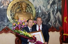 Việt Nam chia sẻ kinh nghiệm trong lĩnh vực tòa án với Lào
