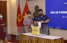 [Photo] TTXVN quyên góp ủng hộ phòng, chống dịch COVID-19