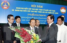 Trao đổi kinh nghiệm công tác Mặt trận hai nước Việt Nam-Lào