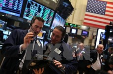 Fed lạc quan hơn về triển vọng kinh tế, chứng khoán Mỹ xanh sàn
