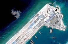 Trung Quốc ngang nhiên điều máy bay vận tải ra đá Chữ Thập