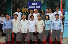 [Photo] Lễ gắn biển tên đường nhà báo, liệt sỹ Trần Kim Xuyến