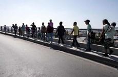 Mỹ lập cơ sở dữ liệu phóng viên đưa tin về đoàn người di cư