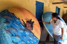 [Photo] Độc đáo những bức tranh vẽ trên thuyền thúng của ngư dân
