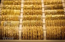 Giá vàng trên thị trường châu Á rời khỏi đỉnh 1.980,57 USD mỗi ounce