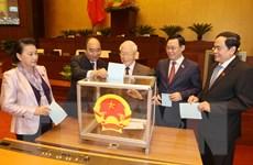 [Photo] Quốc hội tiến hành bỏ phiếu miễn nhiệm Chủ tịch nước