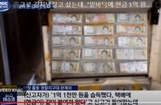 Người đàn ông Hàn Quốc tìm thấy 130.000 USD dán dưới đáy tủ lạnh cũ