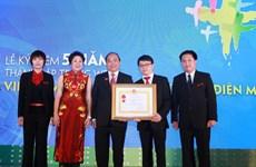Báo Vietnam+ đón nhận Huân chương Lao động hạng Ba