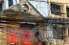 """""""Trảm"""" hàng triệu mét dây cáp thừa trên cột điện, cột chiếu sáng"""
