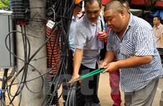 Hà Nội: Bỏ thiết bị lại hiện trường vì bị phát hiện hàn cáp vi phạm