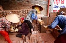 [Photo] Tấm ảnh nữ công nhân làm gạch 'đưa' người chụp tới Nhật Bản
