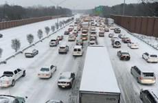 Thời tiết khắc nghiệt làm chậm tốc độ tăng trưởng của Mỹ