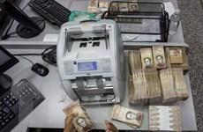 Venezuela hoãn ra mắt đồng tiền mệnh giá lớn tới ngày 16/1