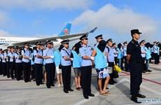 Trung Quốc dẫn độ 77 nghi phạm gian lận viễn thông từ Fiji