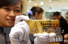 """Giá vàng trên thị trường châu Á chạm mức """"đáy"""" của hai tuần"""
