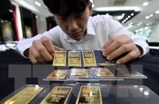 Giá vàng trên thị trường châu Á đi xuống trong phiên đầu tuần